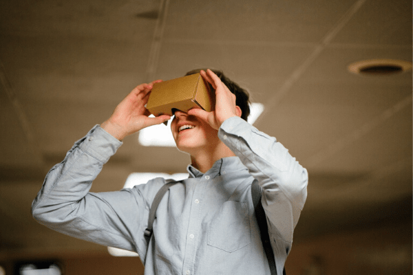 Business Intelligence - man watching a cardboard