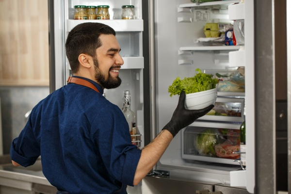 Food Service Case Study Worker on Refrigerator