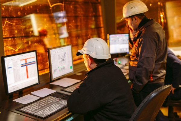 Two workers analyzing data generate by Power Automate tools