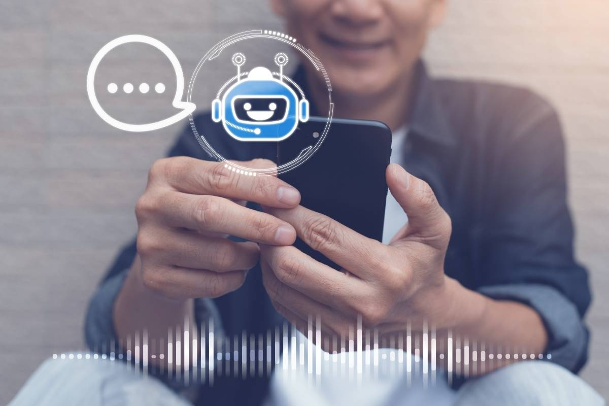 Man looking a phone in conversational AI experiences for the enterprise